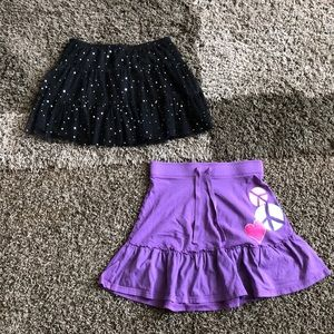Two girls skirts.